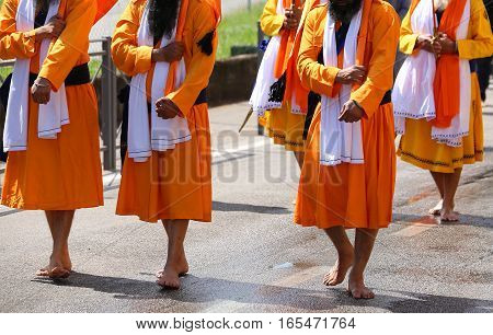 Sikh Barefoot Men Walk With Swords In Hand Through The Streets O