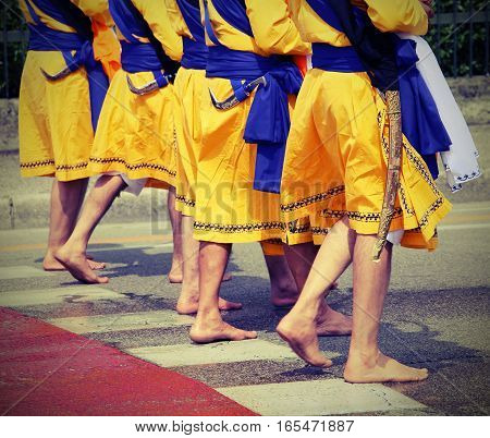 Five Men Of Sikh Religion With Long Dresses Walking Barefoot
