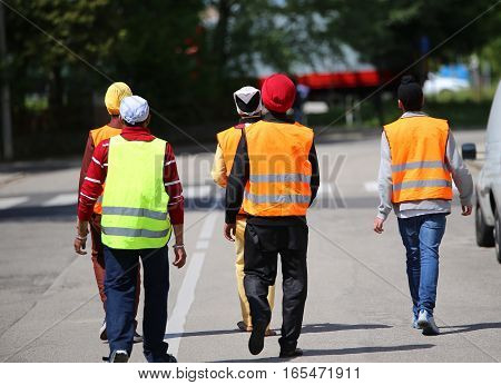 Young Boys With Turbans And The High Visibility Jackets Walking
