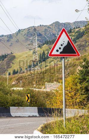 Danger Falling Stones. Landslide Road Sign In The Mountains, Almaty, Kazakhstan