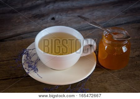 Cup Of Tea With Honey In Jar On The Wooden Table