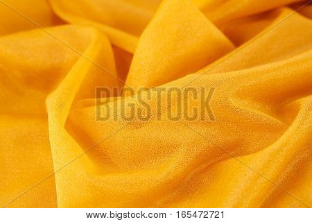 Yellow wrinkled fabric as a background, horizontal picture.