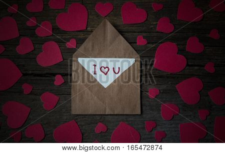 Envelope With Card And Text I Love You And Red Hearts For Valentine Day On Wooden Background