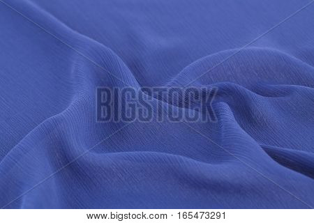 Violet fabric texture as a background, close up picture.