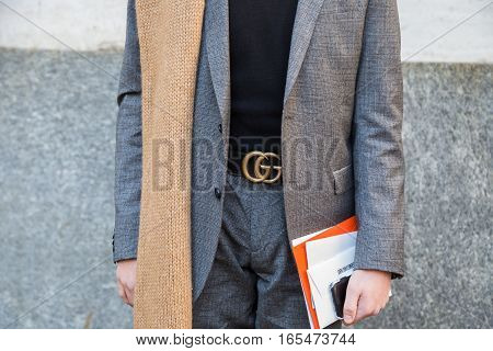 MILAN ITALY - JANUARY 15: Detail of a fashionable man poses outside Ferragamo fashion show building during Milan Men's Fashion Week on JANUARY 15 2017 in Milan.