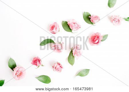 Pink roses buds on white background. Flat lay top view. Valentine's background