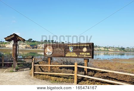 NEWPORT BEACH CALIFORNIA - JANUARY 16 2017: Upper Newport Bay Ecological Reserve sign. The reserve provides approximately 1000 acres of open space and natural habitat.