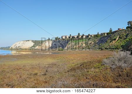 NEWPORT BEACH CALIFORNIA - JANUARY 16 2017: Bluffs and Upper Newport Bay Ecological Reserve. With plastic covered hillside to prevent erosion.