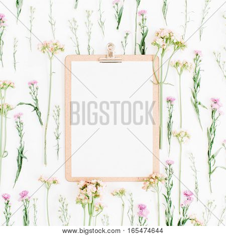 Clipboard mock up and wildflowers pattern. Flat lay top view