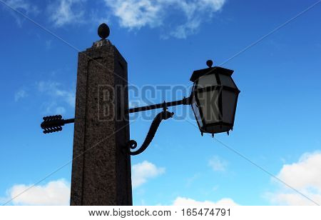 Street lamp decorated with molded figure in the form of a seahorse. Krasnogvardejskij bridge across the Griboyedov Canal. St. Petersburg. Russia.
