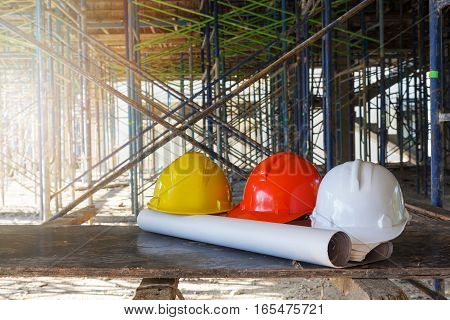 Construction concepts, Helmet in Construction Site with blueprint
