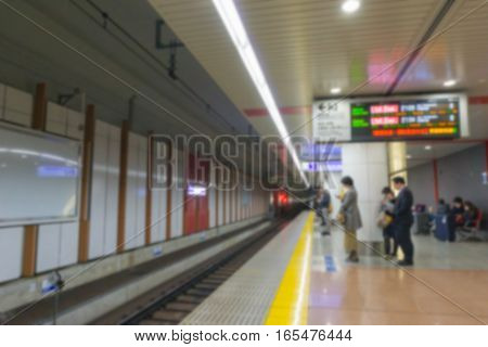 Blurred background. Tokyo train station in Tokyo , Japan