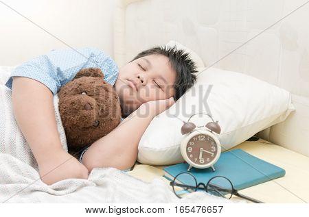 Fat Boy Sleep And Hug Teddy Bear On Bed