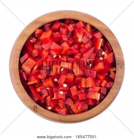 Sliced red pepper in a wooden bowl. Top view.