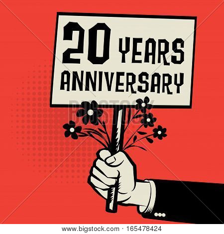 Poster in hand business concept with text 20 years anniversary vector illustration