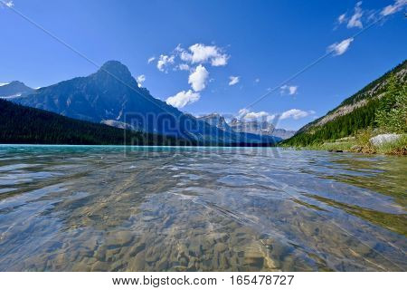 Blue lake with clear water and rocky mountains. Canadian Rocky Mountains. Banff National Park. British Columbia. Canada.
