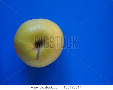 Green Apple Fruit Food Over Blue With Copy Space