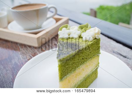 green tea cake with coffee breakfast set in outdoor restaurant