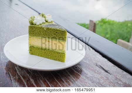 fresh green tea cake in outdoor cafe