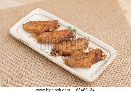Fried chicken wings and crispy garlic in plate