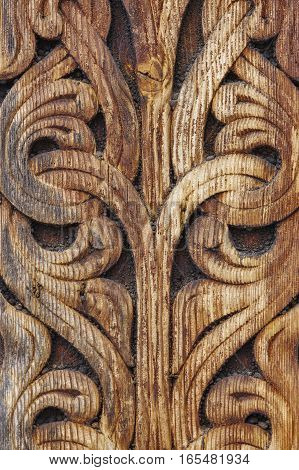 Norwegian ancient wooden carving. Nature forms. Heddal church. Norway. Vertical