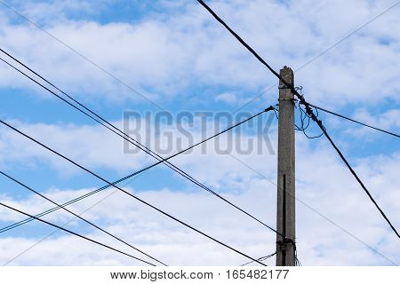 electricity post for house power supply with sky background