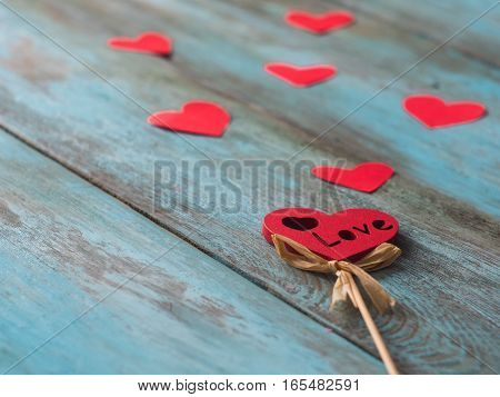 Valentines Day background with hearts. Hearts on blue wooden bacground.