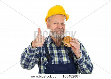 Picture of a confident engineer having a hamburger
