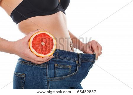 Close up picture of woman's weightloss with grapefruit diet