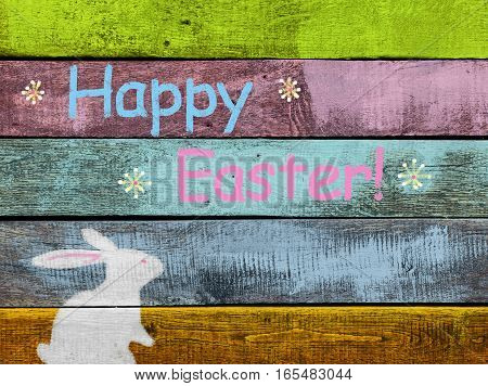 Chalk Bunny on colorful wooden background to Easter