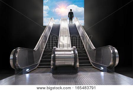 escalator lead businessman to a blue sky and sun