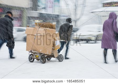 Poor Man Pulling A Cart With Cardboard