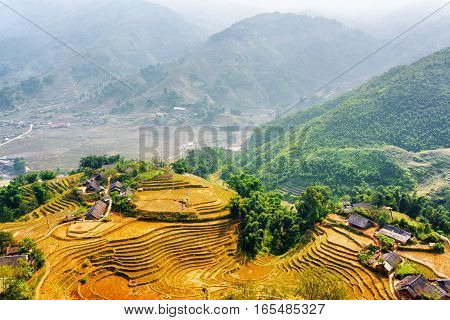 Top View Of Village Houses And Terraced Rice Fields At Highlands