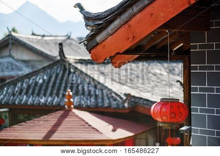Traditional Chinese Black Tile Roof Decorated With Red Lantern