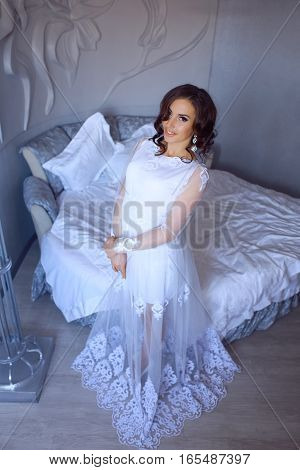 Portrait of beautiful bride. Morning of the bride. Wedding morning. Brunette girl with long wavy hair.