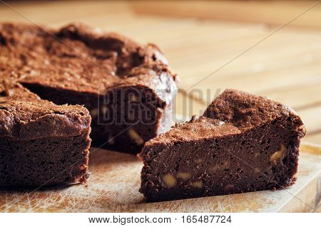 Piece Of Freshly Baked Chocolate Brownie Cake With Walnuts