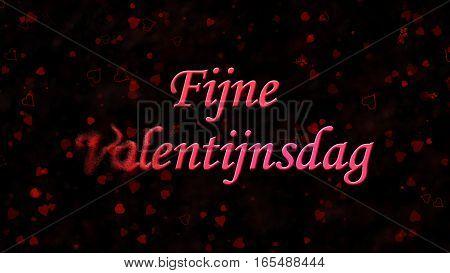 """Happy Valentine's Day Text In Dutch """"fijne Valentijnsdag"""" Turns To Dust From Left On Dark Background"""