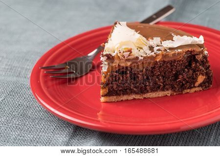 delicate chocolate cake decorated with white chocolate flakes