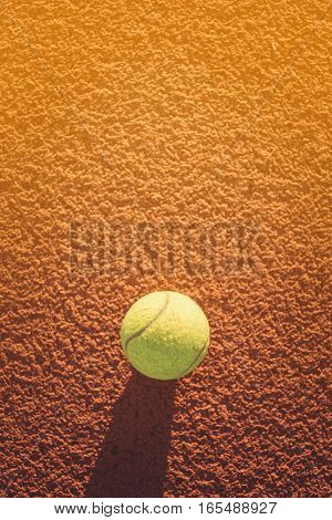 Close up of tennis ball on clay court./Tennis ball vintage tone, Tennis concept, play  tennis, Tennis ball green color, Tennis ball, Tennis ball yellow color, Tennis sport