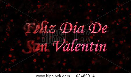 "Happy Valentine's Day Text In Spanish ""feliz Dia De San Valentin"" Turns To Dust From Left On Dark Ba"