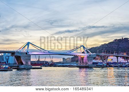 Europa Bridge at the entrance to Port Vell Barcelona, Catalunya Spain. Beautiful peaceful view sunset sky