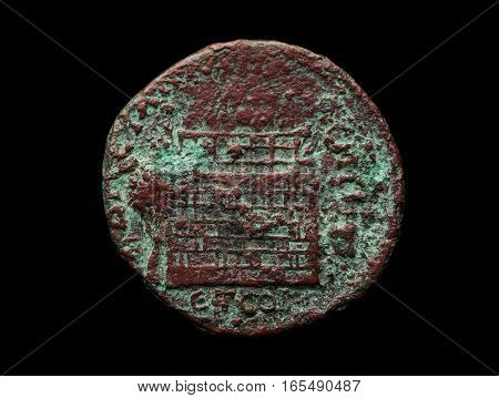 Ancient Bronze Roman Coin Isolated On Black