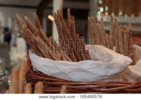 Whole Breadsticks With Flour Inside Wicker Basket: Bakery Products
