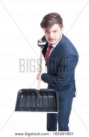 Man Wearing Suit Holding Snow Shovel Looking Mad