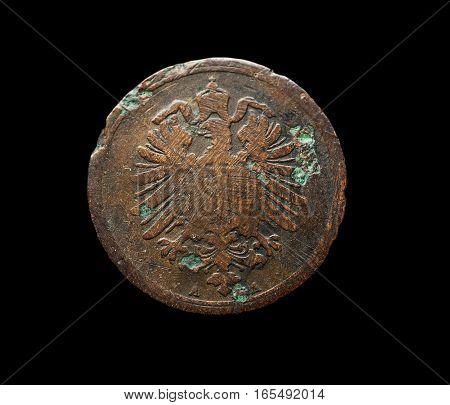 Very Old German Copper Coin With Eagle Isolated On Black