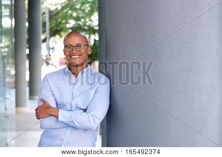 African Businessman With Glasses Smiling Outside