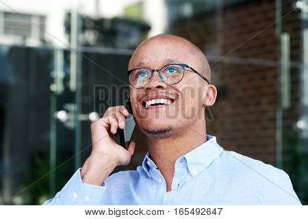 African Businessman Smiling With Cell Phone