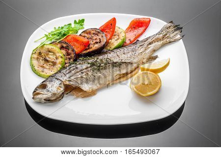 pan fried grilled roasted cooked whole fish trout sea bass salmon cod salad lemon white plate