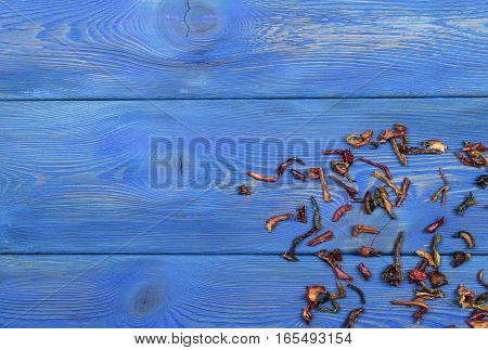 blue wooden texture background with dried pepper