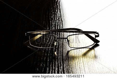 modern glasses to eye protection with yellow lenses on a contrasting background